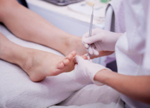 female foot pedicure in beauty salon