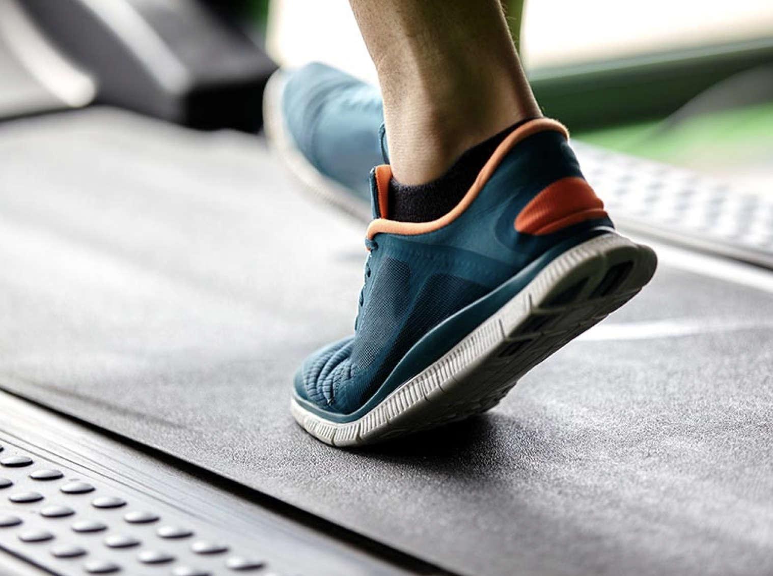 Person walking on treadmill.